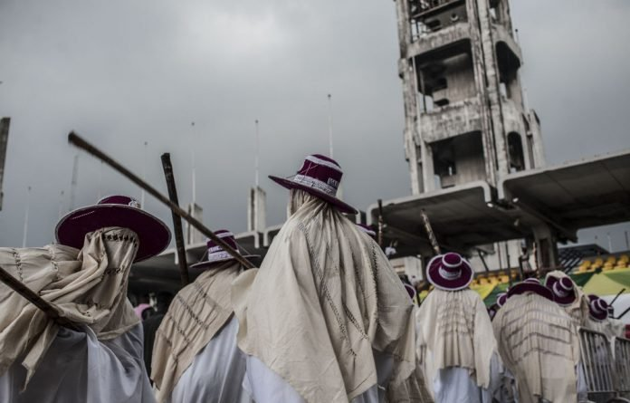 Mass worship: Eyo masqueraders entertain the crowd at the Tafawa Balewa Square in Lagos.