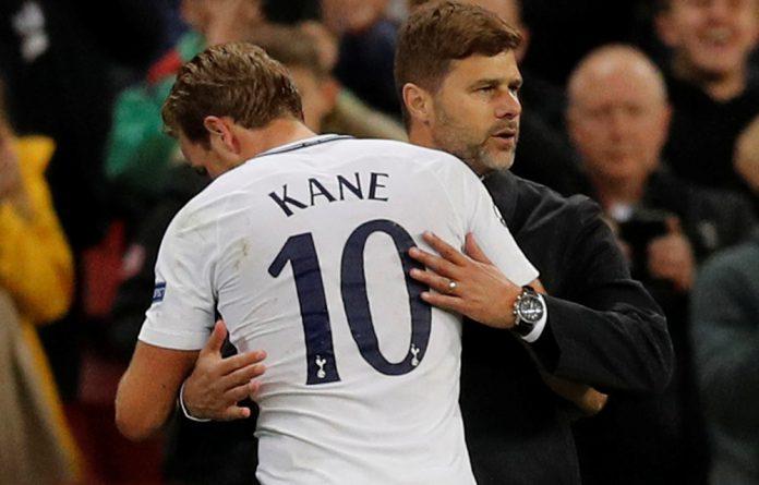 Mauricio Pochettino greets hero of the night Harry Kane.