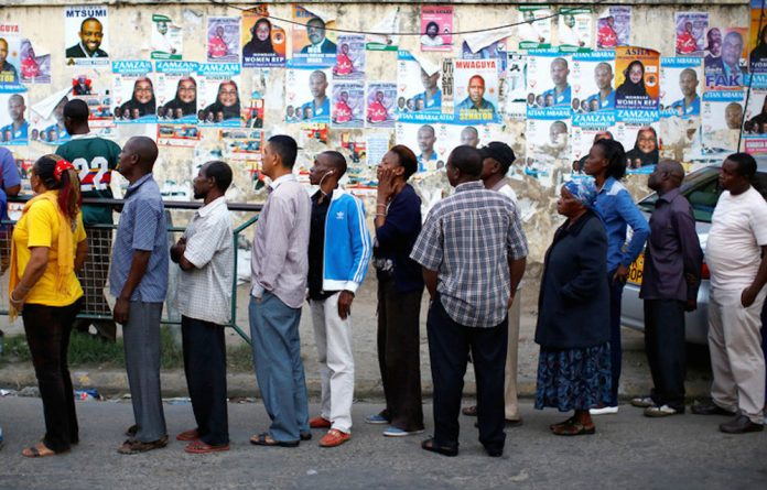 Early rise: Kenyan voters stand in line from the early hours of August 8 2017 for the general elections