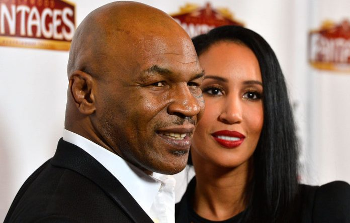 Mike Tyson with his wife Kiki.