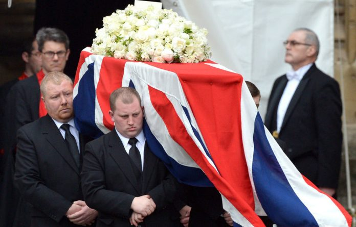 Pallbearers carry the coffin of Britain's former prime minister Margaret Thatcher.