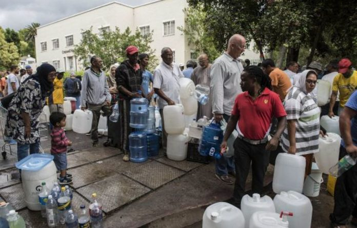 Queues are getting longer at the Newlands spring in Cape Town as people collect free water