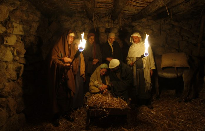 Israeli Arabs perform a nativity scene for tourists in the northern town of Nazareth.