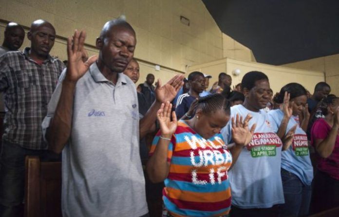 Church of God congregants await spiritual healer Samuel Radebe.