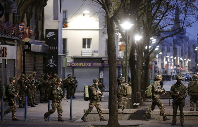 French soldiers secure the area after shots were exchanged in Saint-Denis.