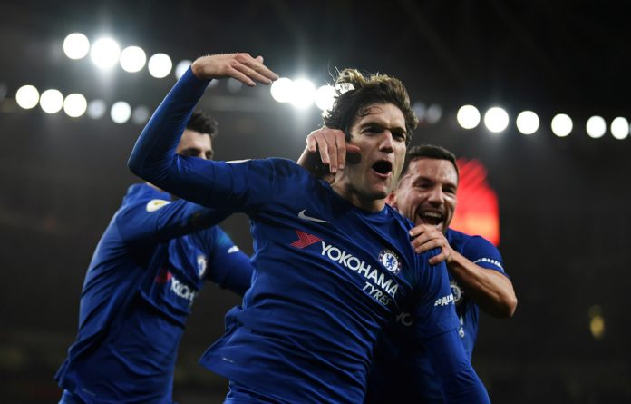 Chelsea's Marcos Alonso celebrates scoring their second goal.