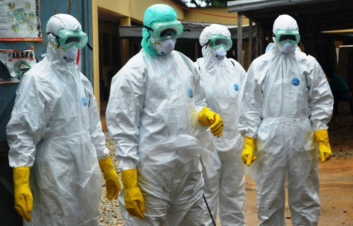 Ebola health workers in Guinea.