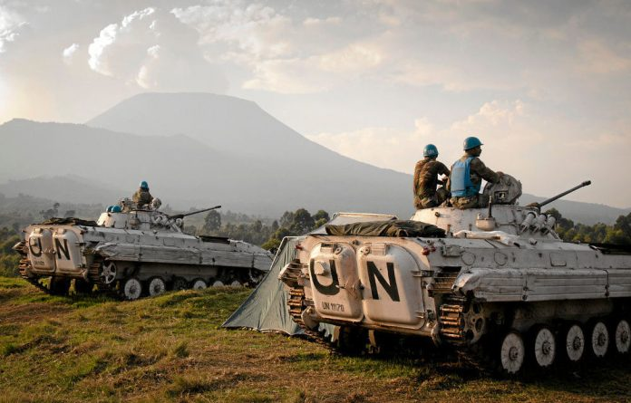 On alert: UN soldiers on patrol near Goma in the Democratic Republic of Congo.