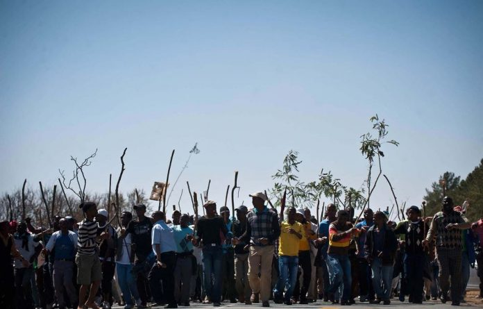 A file photograph of striking workers at Gold Fields