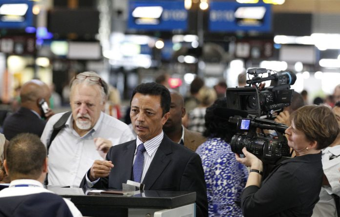Former Madagascar leader Marc Ravalomanana checks in at OR Tambo airport in Johannesburg on January 21 2012.