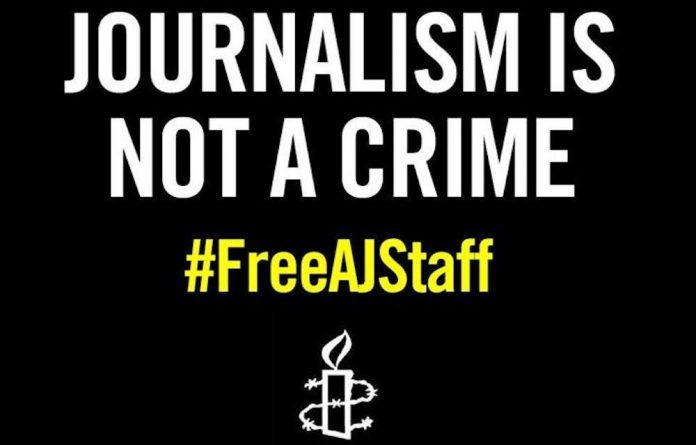 Poster for Amnesty International's campaign for the Al-Jazeera journalists.