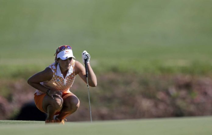 Lexi Thompson lines up her putt on the 17th green during second round play in the Navistar LPGA Classic golf tournament.