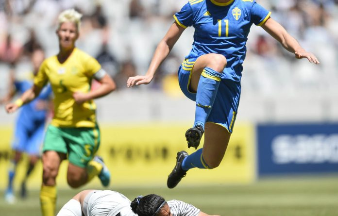 Kaylin Swart of South Africa makes a save from Stina Blackstenius of Sweden during an international friendly match at Cape Town Stadium in January.