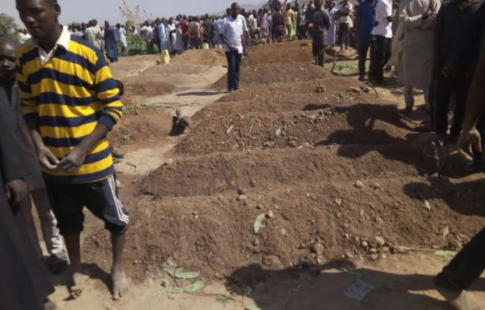The burial of those that lost their lives in Mubi