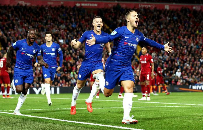 Eden Hazard of Chelsea celebrates after he scores a second goal during the Carabao Cup third-round match between Liverpool and Chelsea.