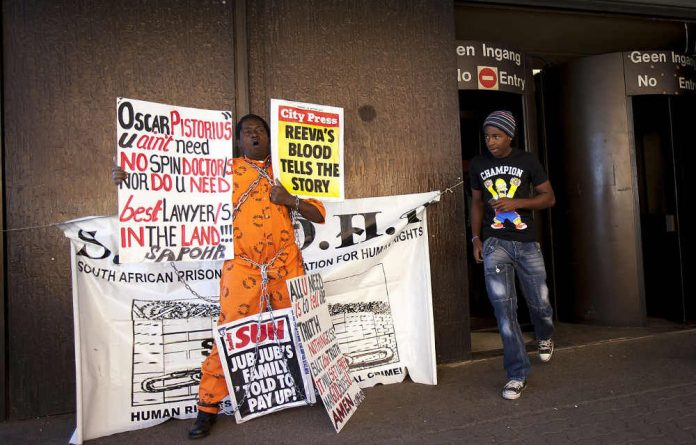 Prisoners' rights activist Golden Miles Bhudu protested at the start of Oscar Pistorius's murder trial.