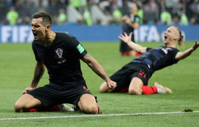 Croatia's Dejan Lovren and Domagoj Vida celebrate after the match