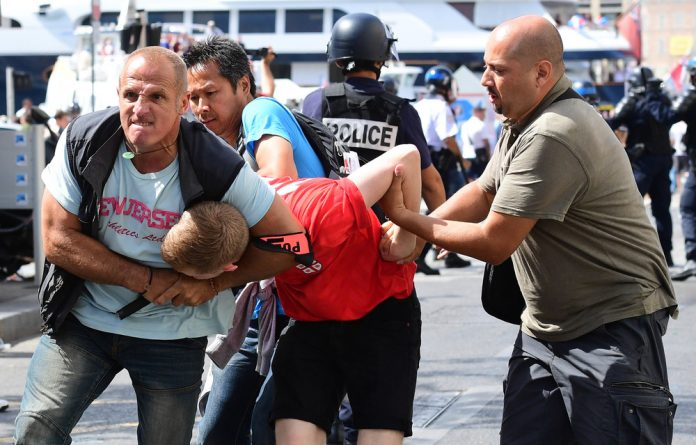Chokehold: A England supporter is detained by authorities after violent clashes between England football fans and police in Marseille
