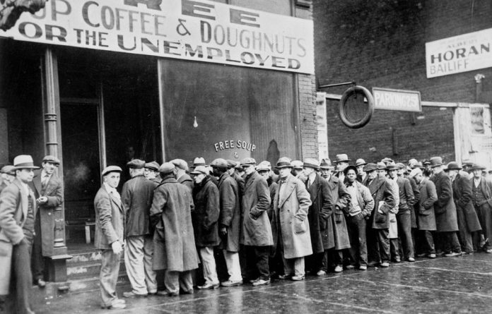 A soup kitchen queue during the Depression.