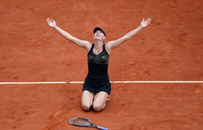 Russia's Maria Sharapova reacts as she defeats Italy's Sara Errani during their women's final match in the French Open tennis tournament at the Roland Garros stadium in Paris. Sharapova won 6-3