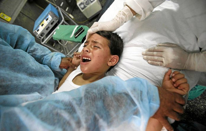 A boy cries while being circumcised at Kouba Hospital in the Algiers. Circumcision is a divisive issue in Europe.