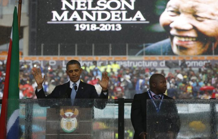 US President Barack Obama next to the sign language interpreter at the Nelson Mandela memorial on Tuesday.