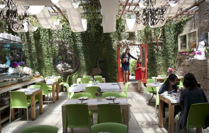 Leafy greens: The garden-like interior of the Pudding Shop in Parktown North.