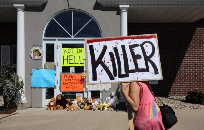 Protesters staked out the clinic of Walter Palmer