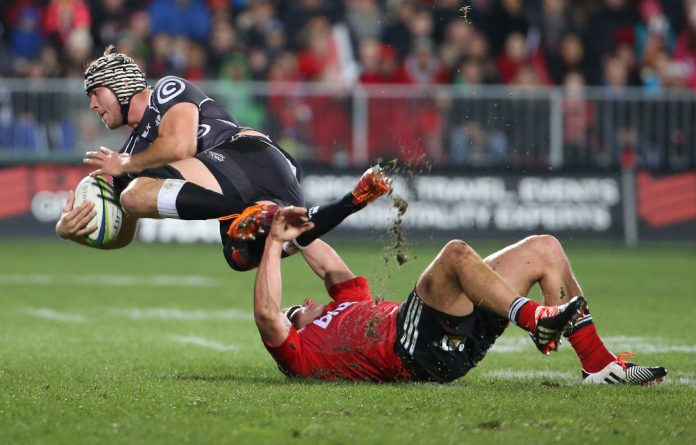 Kieron Fonotia of the Canterbury Crusaders tackles Stephan Lewies of the Sharks at the AMI Stadium in Christchurch on Saturday.