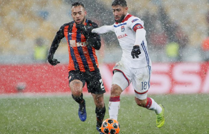 Lyon's Nabil Fekir in action with Shakhtar Donetsk's Maycon