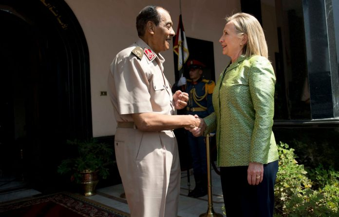 Field Marshal Hussein Tantawi greets US Secretary of State Hillary Clinton before a meeting at the Ministry of Defence on July 15 in Cairo.