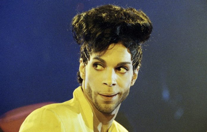 Prince performs during his 'Diamonds and Pearls Tour' at the Earl's Court Arena in London