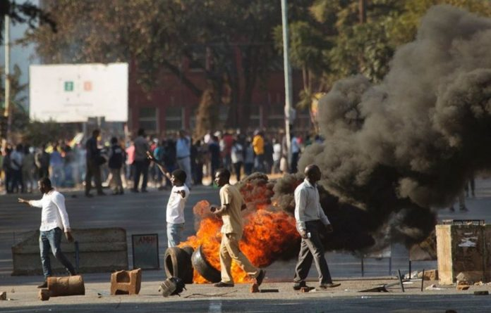 Six people died after troops in the capital Harare opened fire on demonstrators on Wednesday.