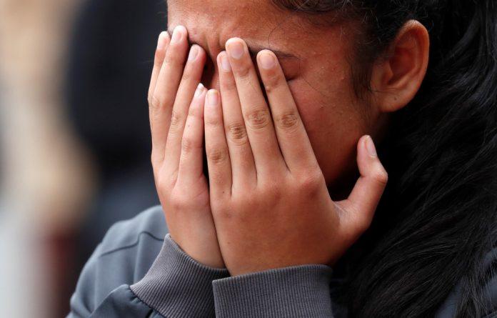 A girl reacts near Masjid Al Noor mosque in Christchurch