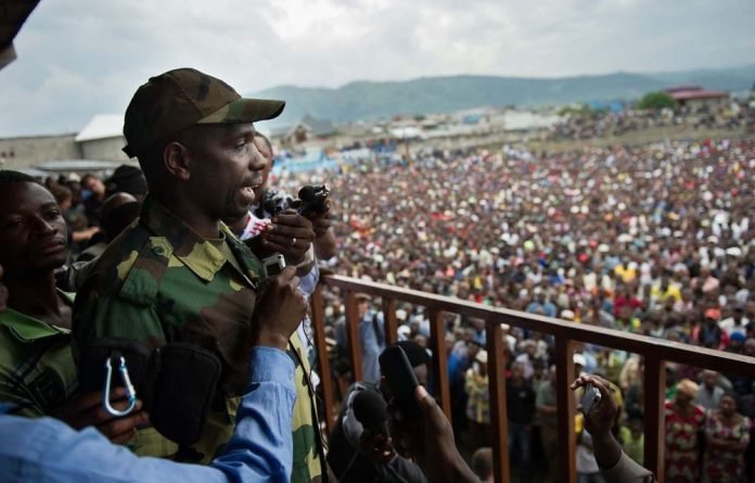 M23 spokesperson Lieutenant-Colonel Vianney Kazarama addresses a crowd in Goma