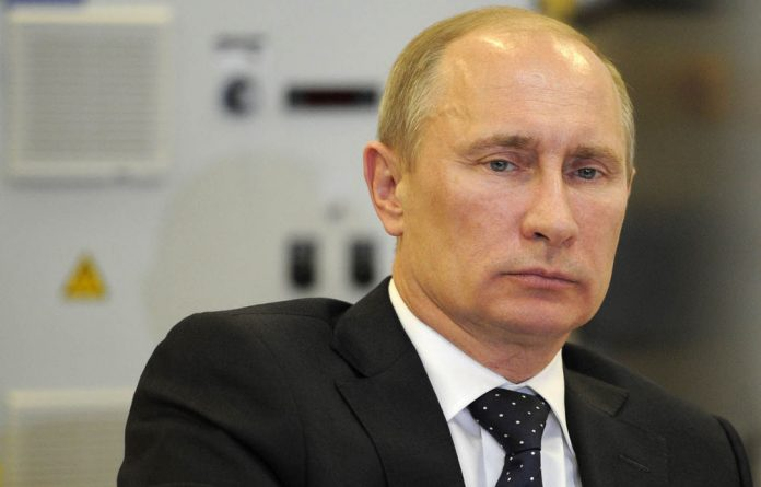 Opposition groups say Putin is trying to silence groups whose criticism of his human rights record has undercut his credibility.