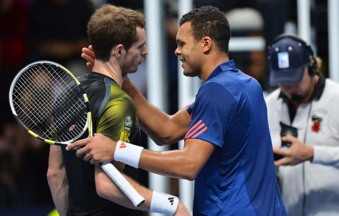 Britain's Andy Murray shakes hands with France's Jo-Wilfried Tsonga after winning their group A singles match.
