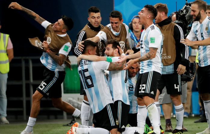 Argentina's Marcos Rojo celebrates scoring their second goal with Lionel Messi and teammates