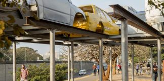An eccentric roadside shelter that features roofing made from scrapped cars has been installed at a popular hitchhiking spot on the N3.