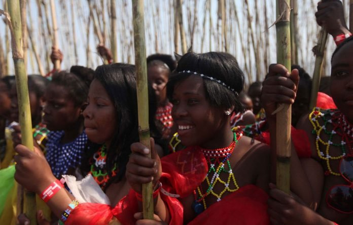 A group of young girls take part in the annual Reed Dance at King Zwelithini's palace at eNyokeni