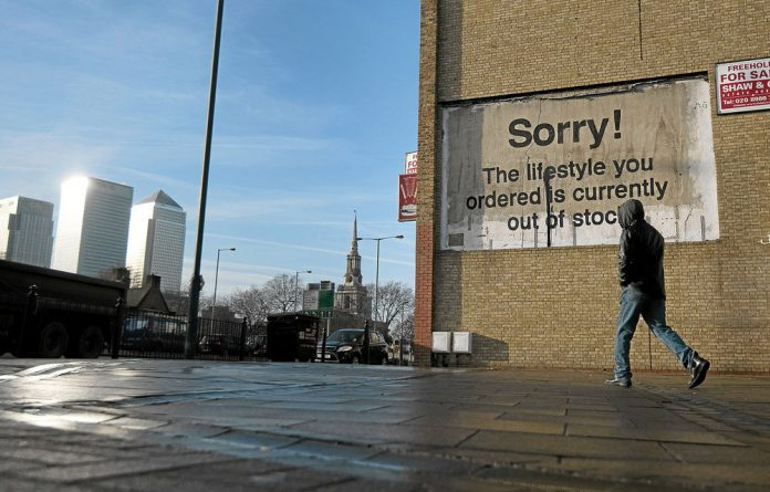 The work of British graffiti artist Banksy on a building in east London says it all after the Bank of England governor wanted to pump another £50-billion into the country's economy.