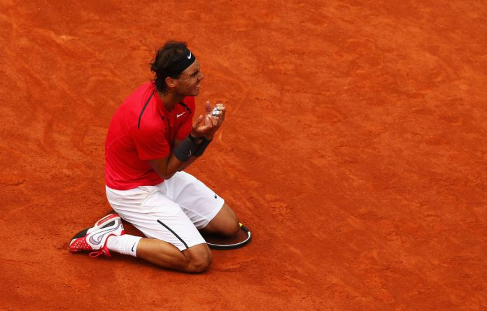 Rafael Nadal of Spain celebrates victory in the men's singles final against Novak Djokovic of Serbia during day 16 of the French Open at Roland Garros.