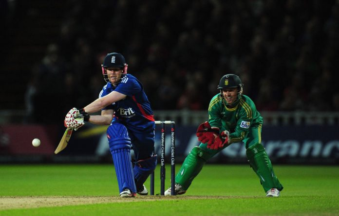England batsman Eoin Morgan prepares to reverse sweep watched by Proteas wicketkeeper AB de Villiers during the third NatWest International T20 between England and South Africa.