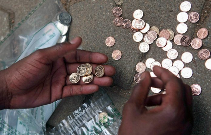 A street vendor in Harare counts the new 'hard' currency.