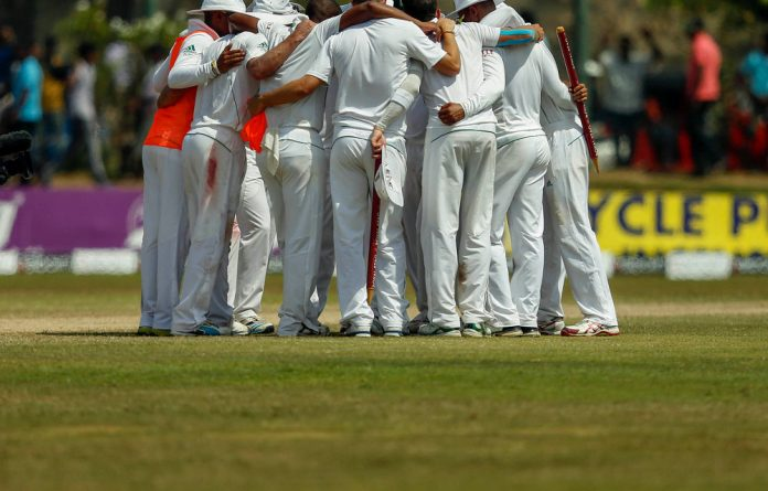 Group hug: The Proteas celebrate after winning the first Test in Sri Lanka last week.