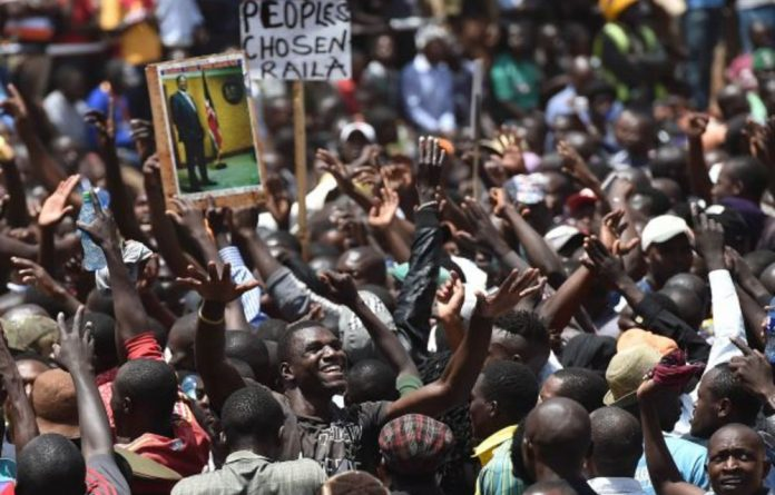 Supporters of Kenya's opposition party cheered on leader Raila Odinga at his 'inauguration'.