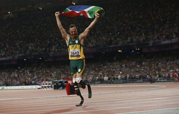 Oscar Pistorius celebrates after winning the men's 400m in the Olympic Stadium on Saturday.