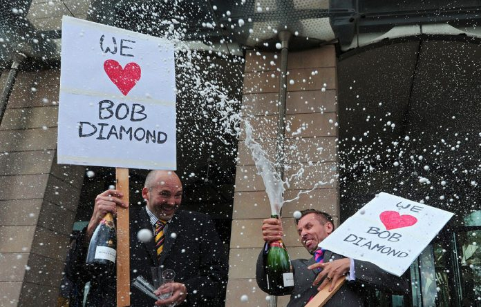 Protesters spray champagne as they demonstrate against what they describe as a