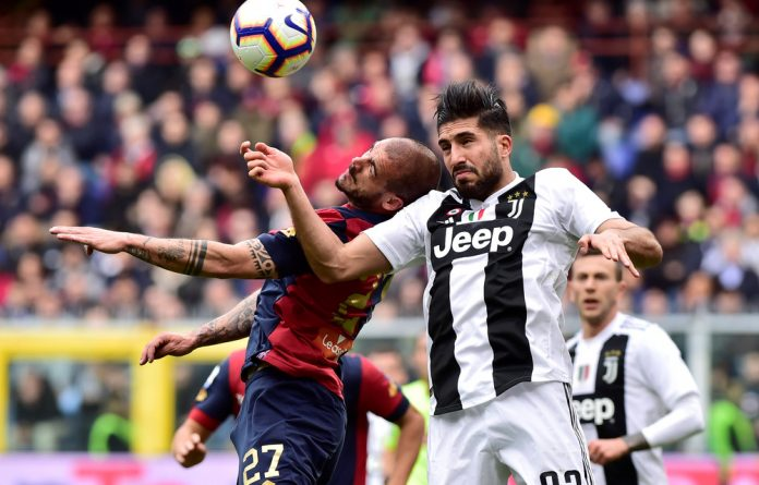 Genoa's Stefano Sturaro in action with Juventus' Emre Can.