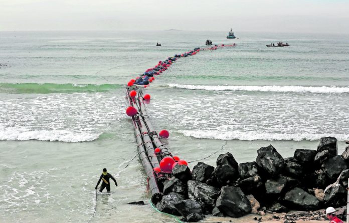Pipe dream: Seawater intake pipes are pulled ashore to attach them to the Strandfontein desalination plant